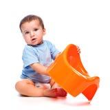 Holding des kleinen Jungen potty Lizenzfreie Stockbilder