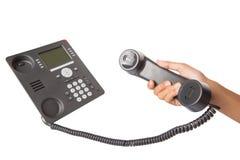 Holding Desktop Telephone Handset IV Stock Image