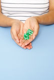 Holding dice Stock Photos