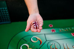 Holding Dice At Craps Table Royalty Free Stock Image