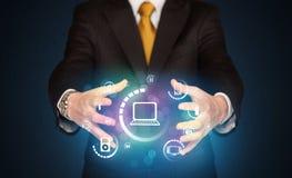 Holding digital media icons Stock Photography