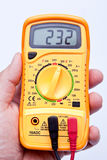 Holding digital multimeter Royalty Free Stock Images