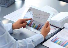 Holding digital tablet Stock Photos