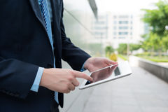 Holding digital tablet Royalty Free Stock Image