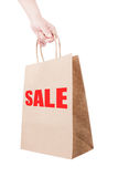 Holding discount shopping paper bag. On white background Royalty Free Stock Images