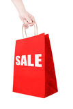 Holding discount shopping paper bag. Isolate Stock Photo
