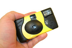 Holding a Disposable Camera. Hand with disposable camera Stock Photo