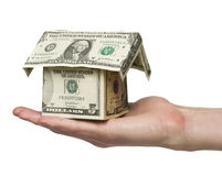 Holding a dollar house Royalty Free Stock Images