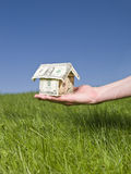 Holding a dollar house Royalty Free Stock Image