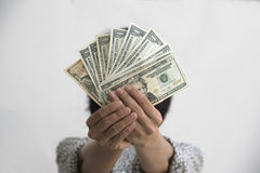 Holding dollar money. A person holding dollar money to the front Royalty Free Stock Images