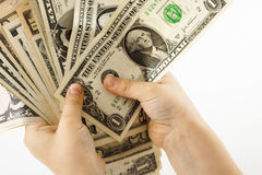 Holding dollars Stock Images