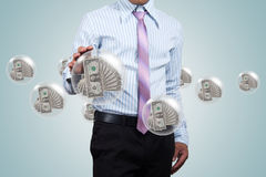 Holding a dollars. Stock Photos