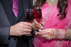 Holding drink. Indian bride and groom holding drink Royalty Free Stock Photos