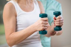 Holding the dumbbells Stock Photography