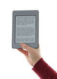 Holding E-book reader in hands Stock Photos