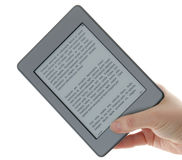 Holding E-book reader in hands Stock Images