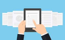 Holding E-book reader in hands. Royalty Free Stock Photos