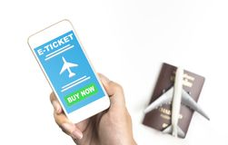 Holding E ticket application for Air travel on Phone screen. Hand holding E ticket application for Air travel on Phone screen Royalty Free Stock Photography