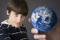 Holding the earth Royalty Free Stock Images