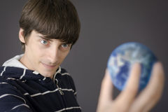 Holding the earth Stock Photo