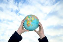 Holding the earth Stock Photography