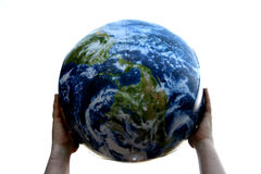 Holding The Earth. Hands holding up the planet earth Royalty Free Stock Photography