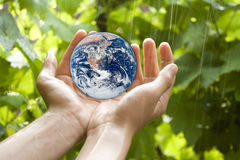 Holding Earth stock photos