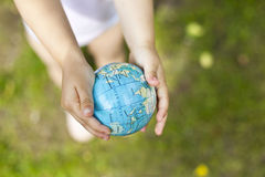 Holding an earth globe in hands Royalty Free Stock Photo