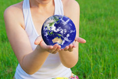 Holding earth in hands Stock Photography