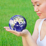 Holding earth in hands Stock Photos