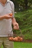 Holding egg basket. Stock Photography