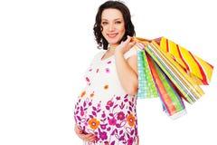 Holding-Einkaufenbeutel der schwangeren Frau Lizenzfreie Stockbilder