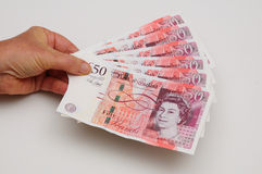 Holding English fifty pound notes. Royalty Free Stock Images