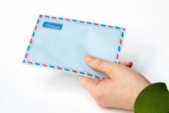 Holding envelope Royalty Free Stock Image
