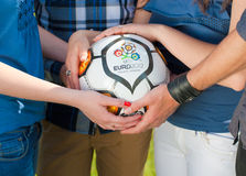 Holding Euro 2012 ball. Closeup on teenagers holding ball with Euro 2012 logo Stock Photos