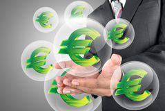 holding Euro money in crystal ball Stock Photography