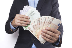 Holding Euros In Both Hands Stock Photography