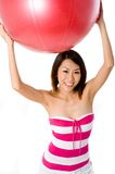 Holding Exercise Ball Stock Photography