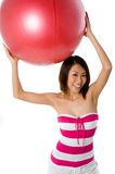 Holding Exercise Ball Royalty Free Stock Image