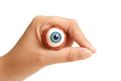 Holding an Eyeball. A person holds an eyeball in their hand Stock Photos
