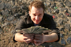 Holding A Fan Of Money Royalty Free Stock Photography