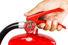 Holding fire extinguisher isolated, with clipping path royalty free stock photos