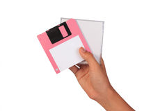 Holding floppy disc on white background. Computer floppy disk in Royalty Free Stock Image