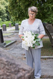 Holding a floral tribute Royalty Free Stock Image