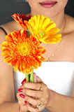 Holding flowers Royalty Free Stock Photo