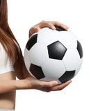 Holding football. Closeup image of woman holding a football in her hand on white background stock photos