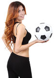 Holding football. Image of woman holding a football on right hand and white background Royalty Free Stock Photography