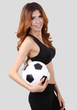 Holding football. Image of woman holding a football on her  right hand Royalty Free Stock Photography