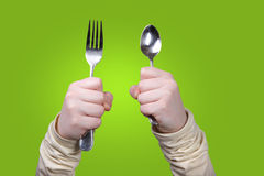 Holding fork and spoon Stock Image