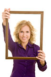 Holding a frame Stock Images